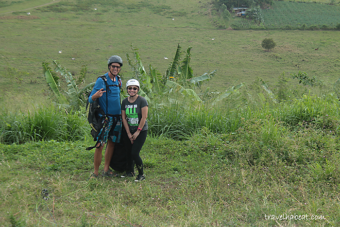 With paragliding pilot.