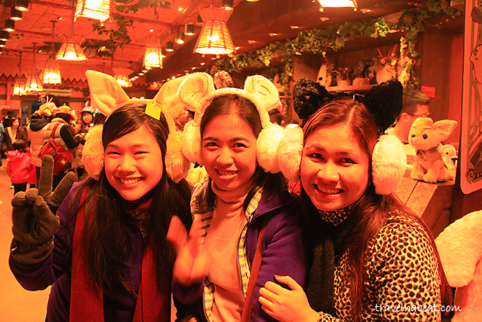 Photo-op with cute animal headdress at the souvenir shop.