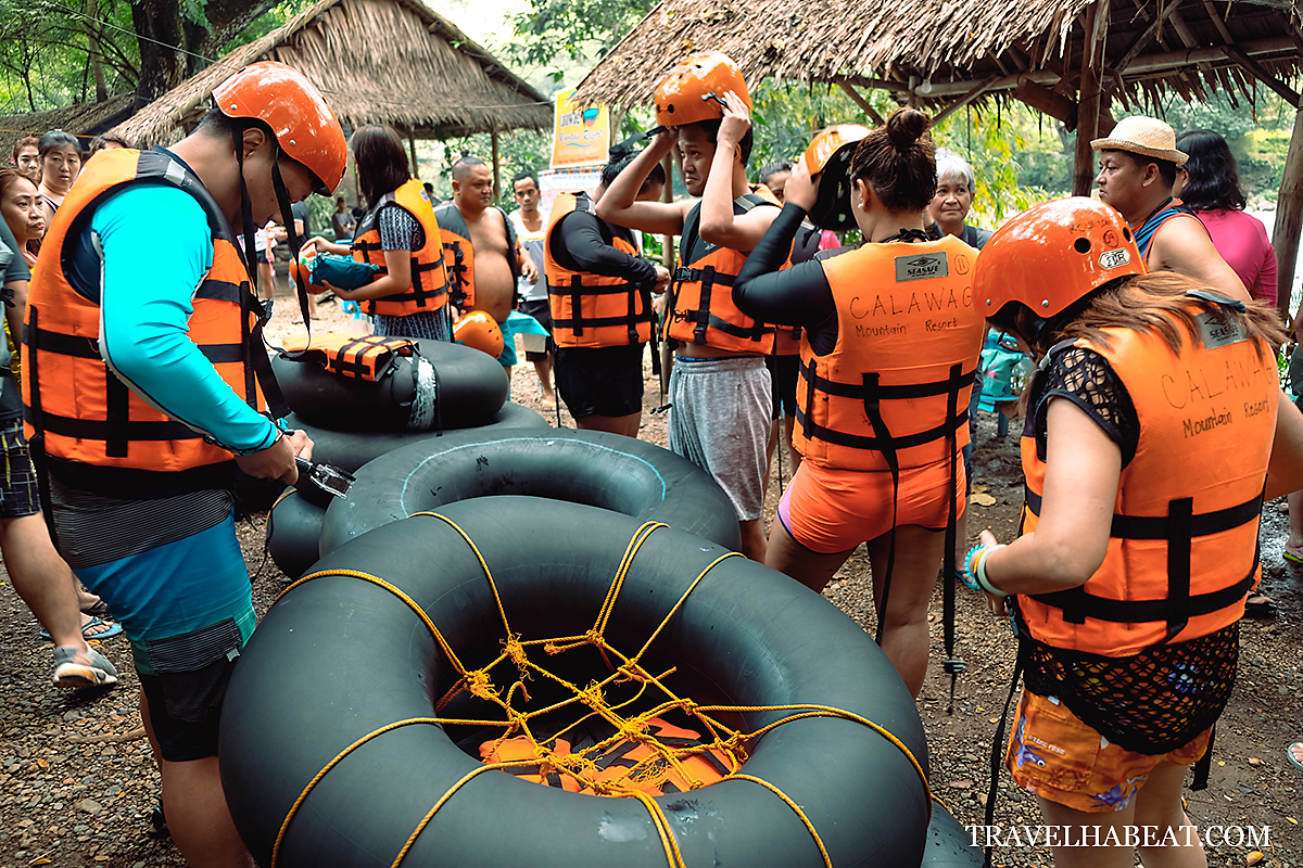 Preparing with the river tubing equipment: helmet, life vest, and tire tube.